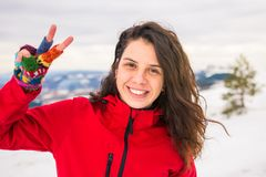 Happy woman on a on snow covered mountain royalty free stock image