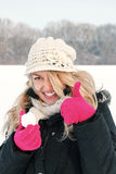 Happy woman in snow holding snow ball in hand for snowballing Royalty Free Stock Images
