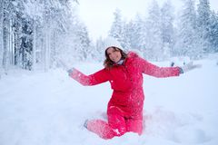 Happy woman in a snow landscape Stock Photography