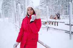 Happy woman in a snow landscape Royalty Free Stock Image