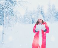 Happy woman in a snow landscape.  Royalty Free Stock Image
