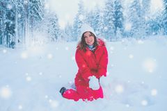 Happy woman in a snow landscape.  Royalty Free Stock Photos
