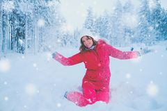 Happy woman in a snow landscape.  Stock Image