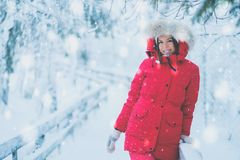 Happy woman in a snow landscape.  Stock Photo