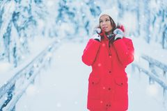 Happy woman in a snow landscape.  Royalty Free Stock Photography