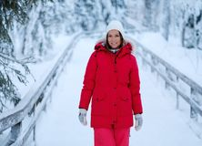 Happy woman in a snow landscape Stock Images