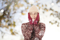 Happy woman in the snow Royalty Free Stock Photo