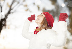 Happy woman in the snow Stock Photos