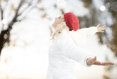 Happy woman in the snow Stock Photo
