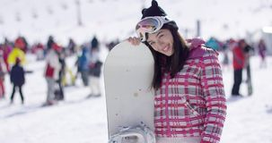 Happy woman with snowboard stock video