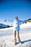Happy woman on snowy mountain Royalty Free Stock Images