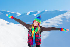 Happy woman in snowy mountains Stock Photography