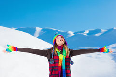 Happy woman in snowy mountains Stock Photos