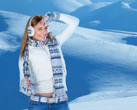 Happy woman in snowy mountains Royalty Free Stock Photo