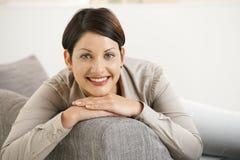 Happy woman on sofa Stock Photo