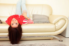Happy woman on sofa Royalty Free Stock Photography