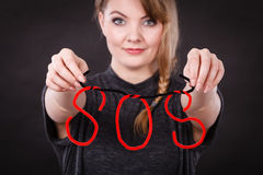 Happy woman with sos sign. Stock Photos