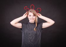 Happy woman with sos sign. Help concept. Young blonde smiling woman with red sos symbol sign. Happy female helper offering support Stock Photo