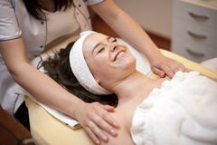 Happy woman on spa massage Royalty Free Stock Photo