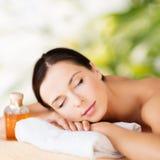 Happy woman in spa salon stock image