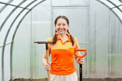 Happy  woman  with spade and rake Stock Photo