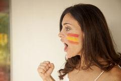 Happy woman with Spain flag. Happy woman smiling with Spain flag royalty free stock image