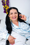 Happy woman speak at phone in morning Stock Photography