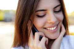 Happy woman speaking on the phone Stock Photo