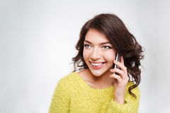 Happy woman speaking on the phone Stock Photography