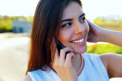 Happy woman speaking on the phone Stock Image
