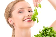 Happy woman with spinach Royalty Free Stock Image