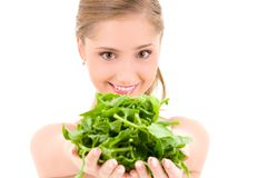 Happy woman with spinach Royalty Free Stock Photos