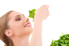 Happy woman with spinach Stock Photo