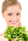Happy woman with spinach Stock Photos