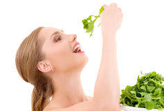 Happy woman with spinach Stock Image
