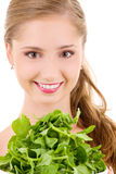 Happy woman with spinach Royalty Free Stock Photography