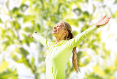 Happy woman in sport clothes raising hands Royalty Free Stock Photography