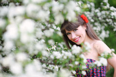Happy woman in the spring, in the lush garden Royalty Free Stock Image