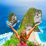 Happy woman stand at high cliff viewpoint, look at sea Stock Image