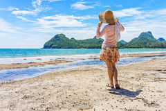 Happy woman is standing on the Ao Manao beach stock photo