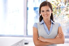 Happy woman standing arms crossed Stock Photo