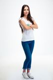 Happy woman standing with arms folded Royalty Free Stock Images