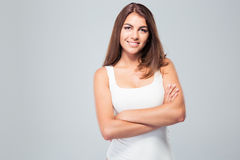 Happy woman standing with arms folded Royalty Free Stock Photography