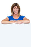Happy woman standing behind whiteboard Royalty Free Stock Photo