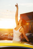 Happy young fashion woman by her car Royalty Free Stock Photography
