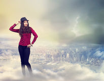 Happy Woman Standing on the Clouds stock photos