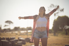 Happy woman standing on field Stock Images