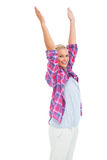 Happy woman standing with hands up in air Stock Image