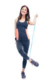 Happy woman standing with jumping rope Royalty Free Stock Photography
