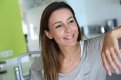 Happy woman standing in kitchen Royalty Free Stock Photos